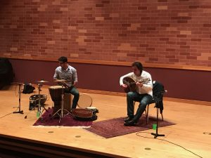 The two performers of the workshop. Percussionists pictured right and guitarist left.